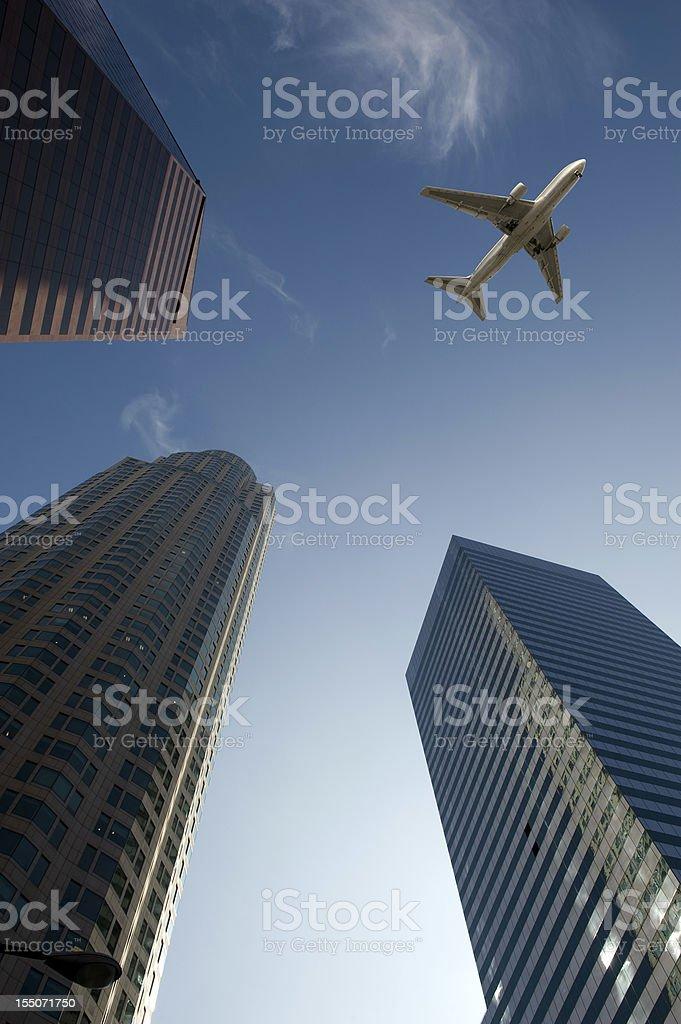 Jet over City stock photo
