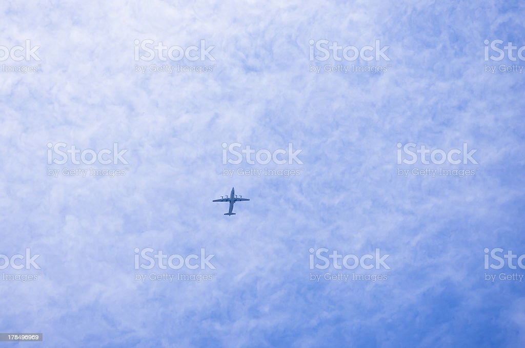 Jet over clouds royalty-free stock photo