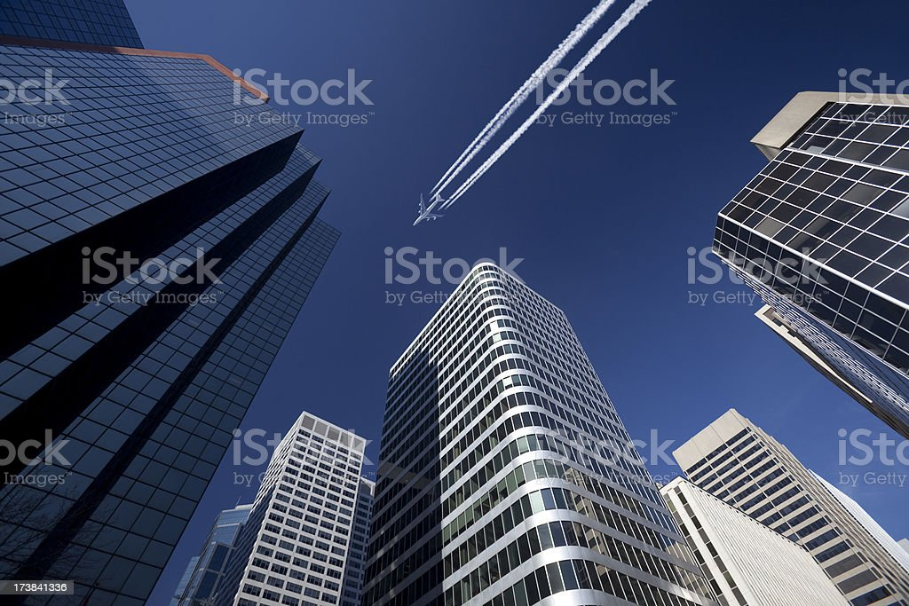 Jet over Downtown royalty-free stock photo