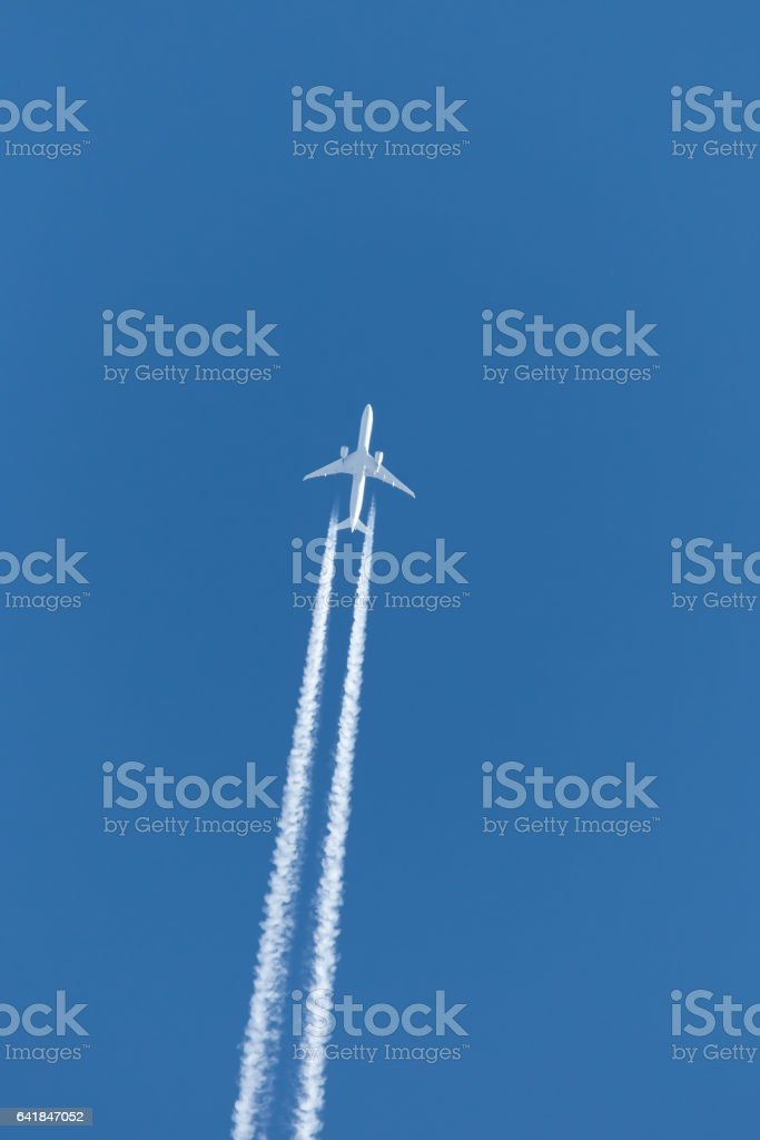 jet plane contrail stock photo