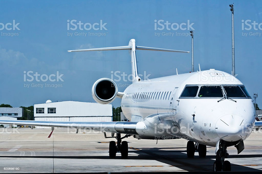 Jet plane in airport stock photo