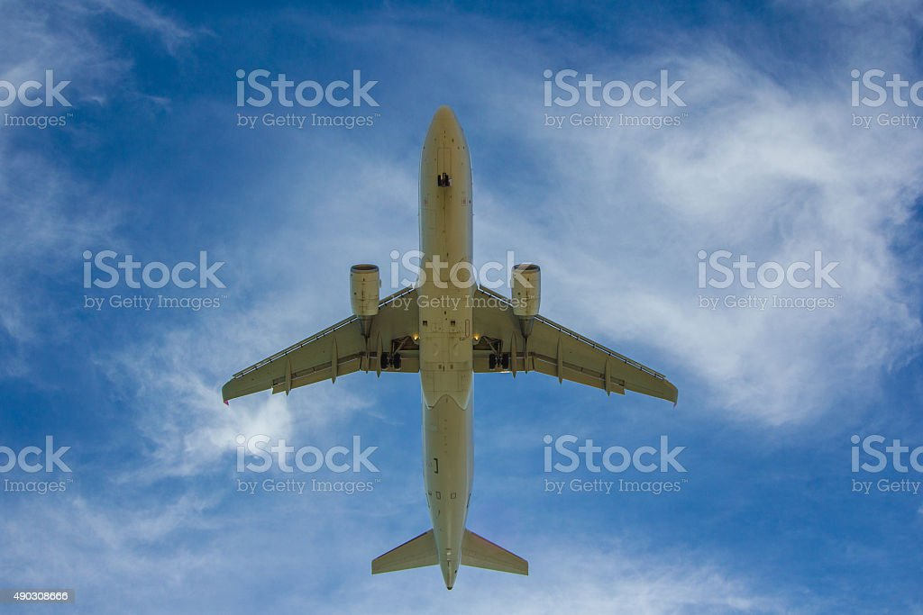 Jet Plane landing with blue sky white clouds background stock photo