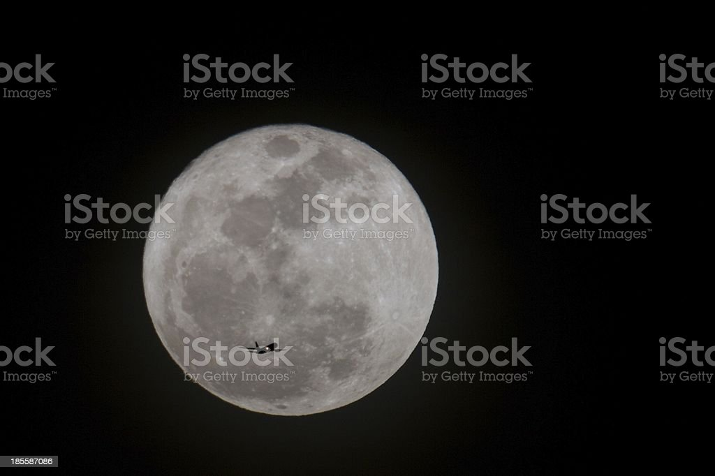 Jet Plane Silhouette with Full Moon stock photo