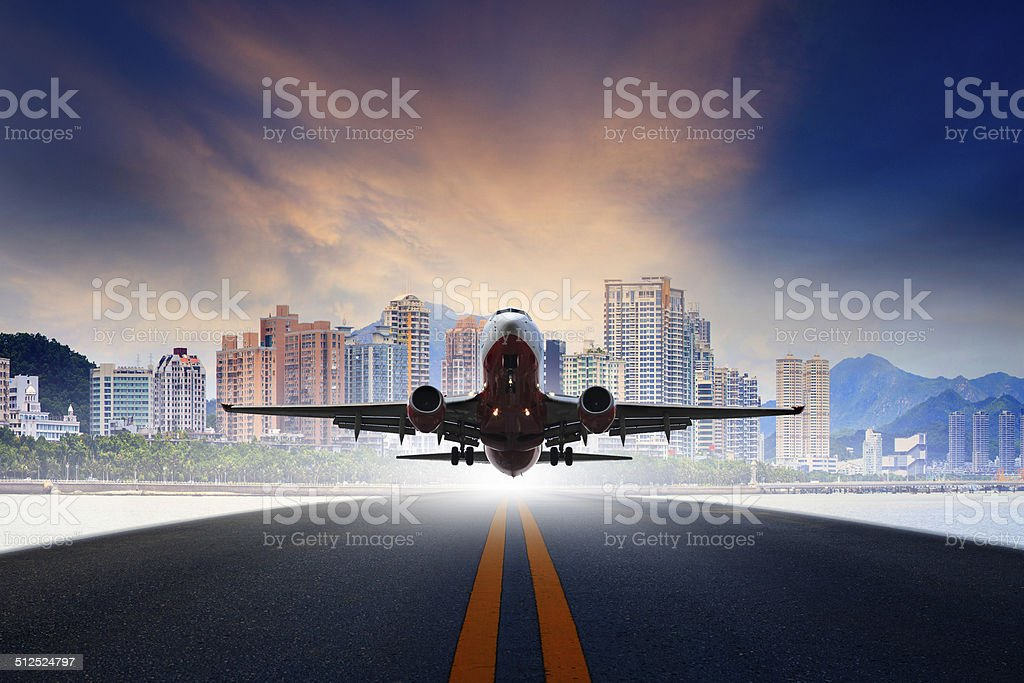 jet plane take off from urban airport runway stock photo