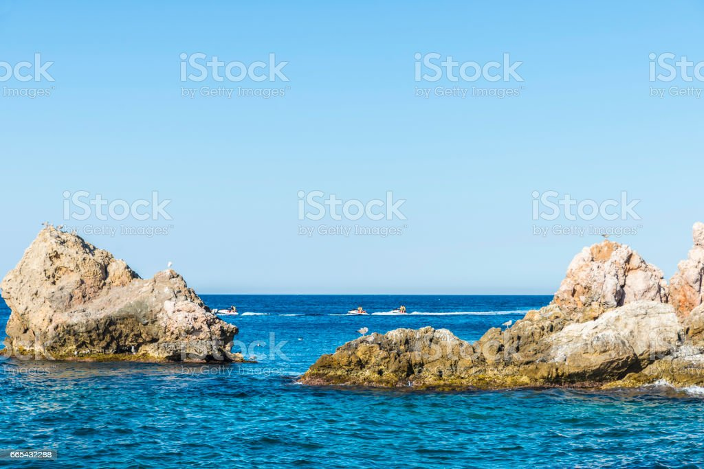 Jet ski sailing in the Medes islands at the Costa Brava, Spain stock photo
