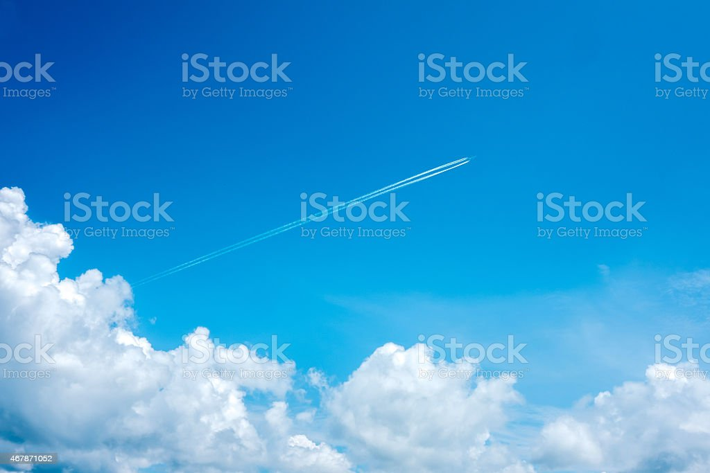 Jet steam out of clouds stock photo