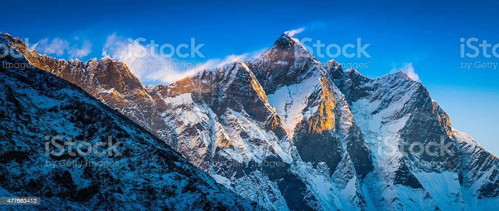 Jet stream clouds sunrise Nuptse Lhotse 8000m mountain peaks Himalayas stock photo
