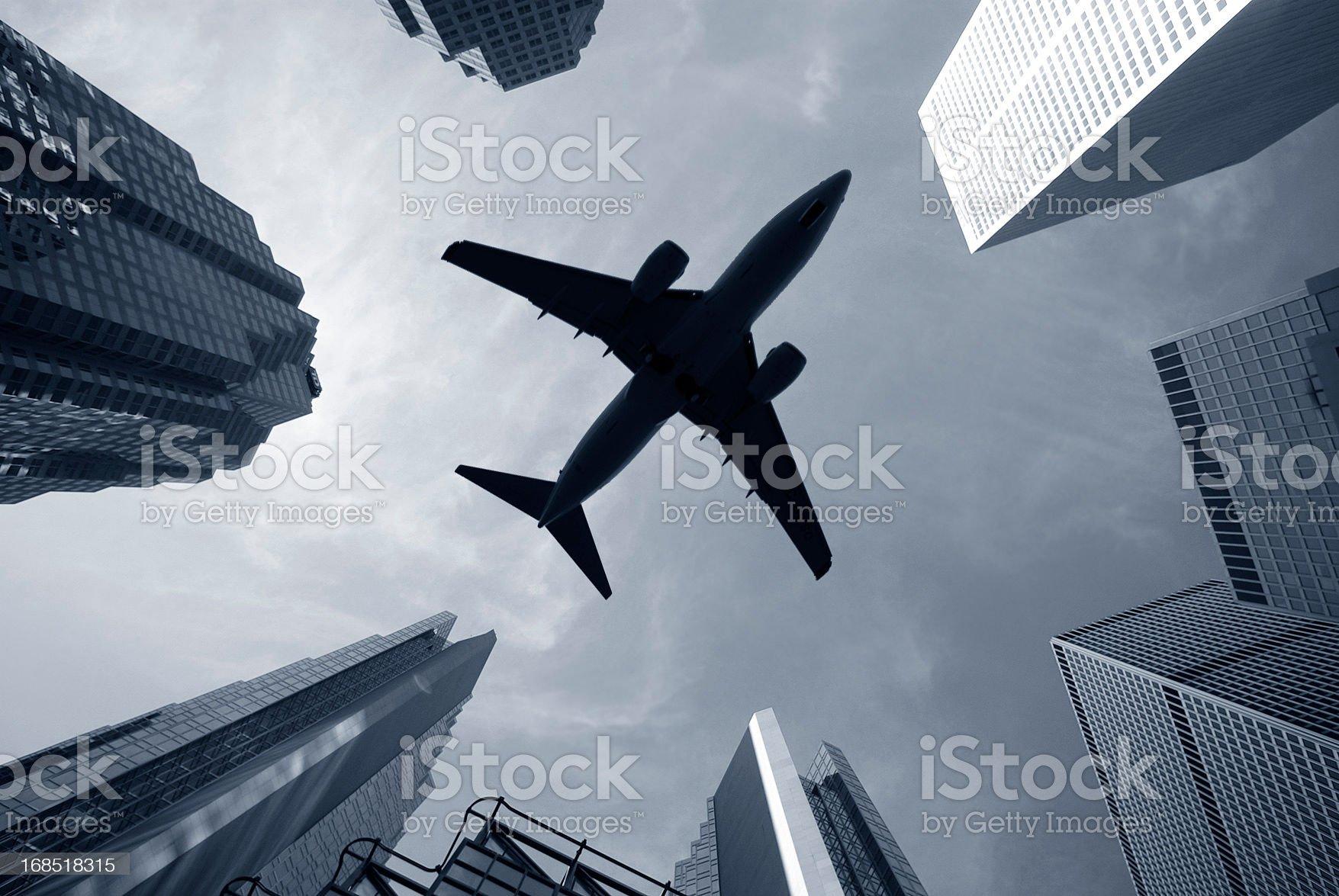 jet takes off over city skyscapers royalty-free stock photo