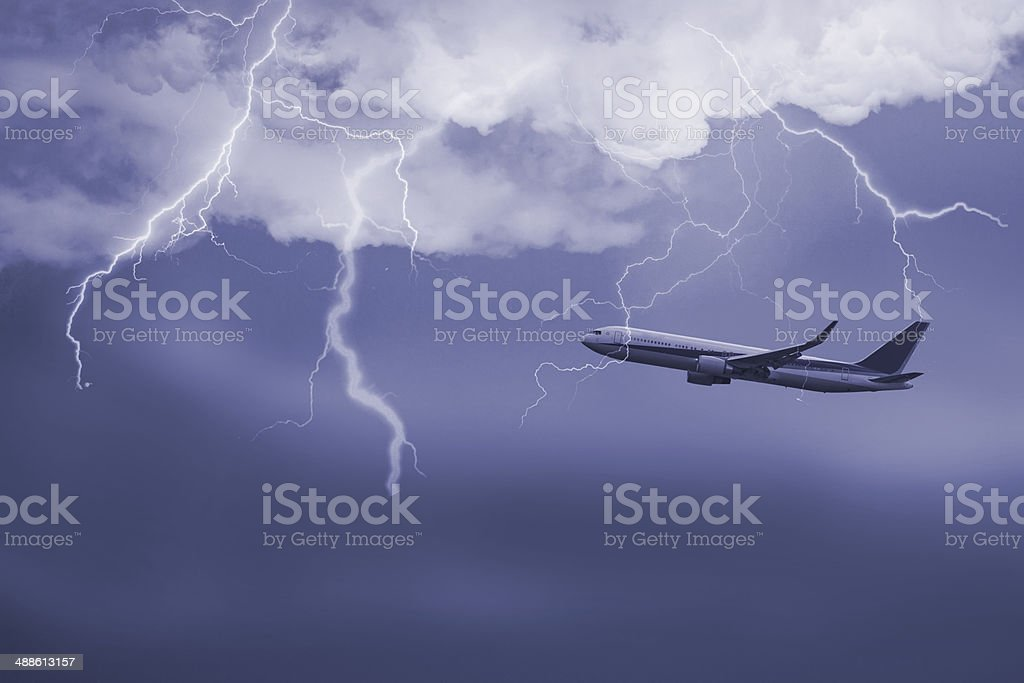jet travelling through  stormy sky stock photo