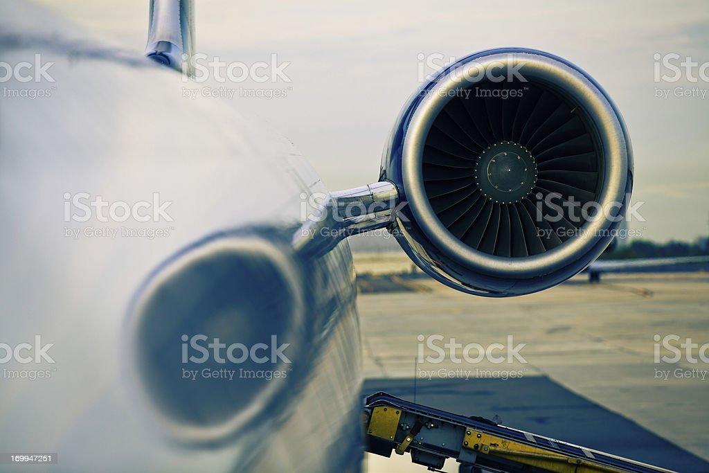 Jet Turbine and Luggage Conveyor Belt royalty-free stock photo