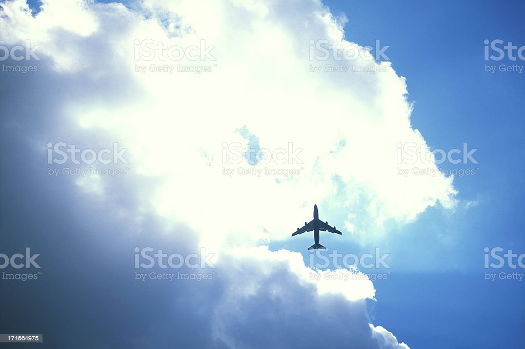 Jet under the clouds royalty-free stock photo