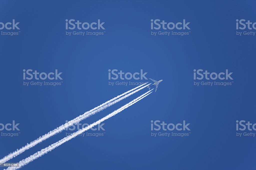 Jet with vapor trail royalty-free stock photo