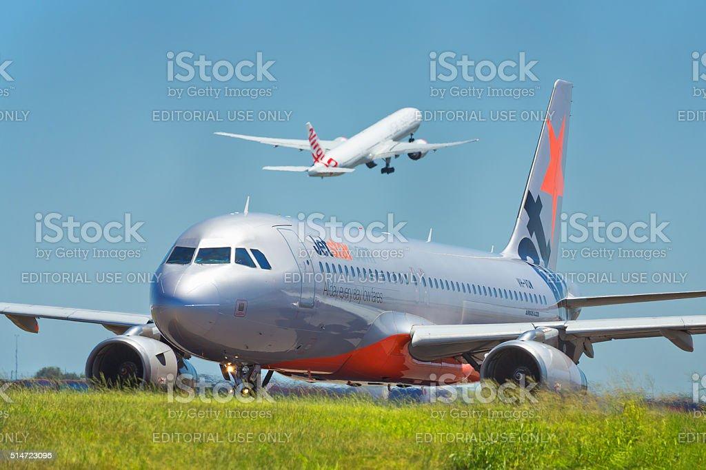 Jetstar and Virgin Australia jets at Sydney Airport stock photo