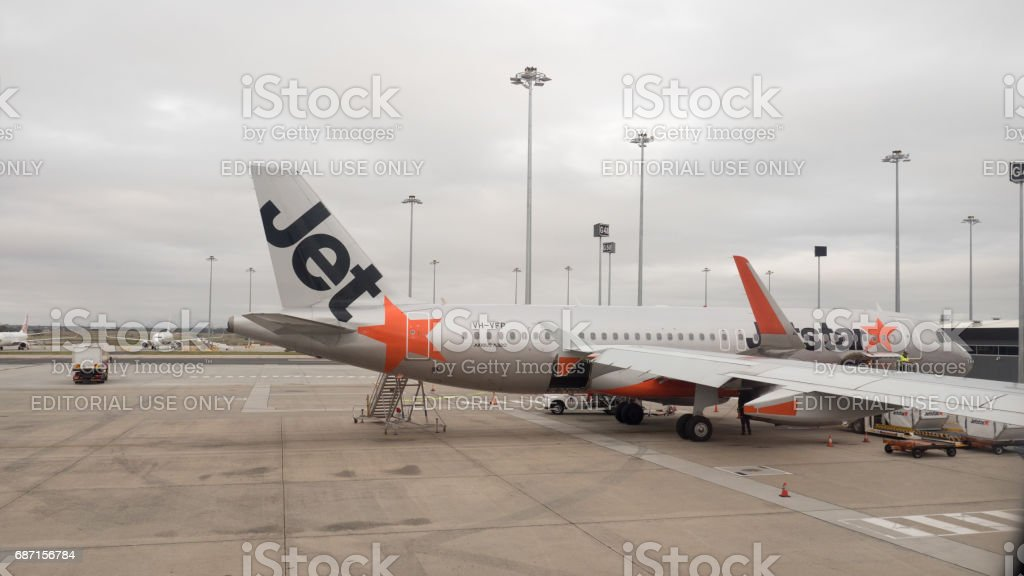 Jetstar commercial airline at the gate at Melbourne Airport 4k stock photo