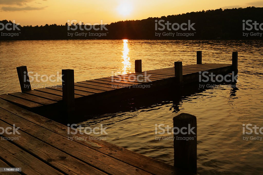 Jetty and sunset over lake royalty-free stock photo