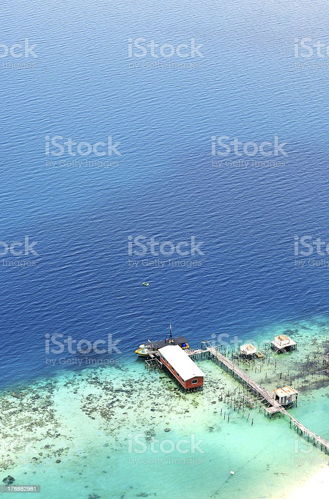 Jetty and turquoise water in Bohey Dulang,Semporna royalty-free stock photo