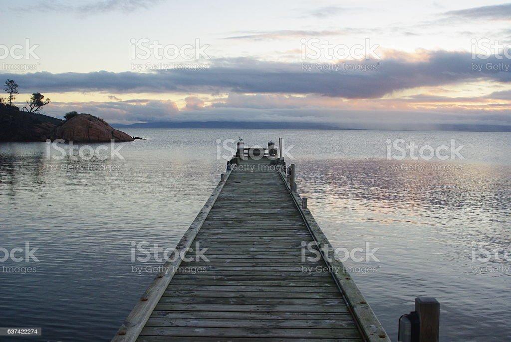 Jetty at dusk, Freycinet Tasmania stock photo