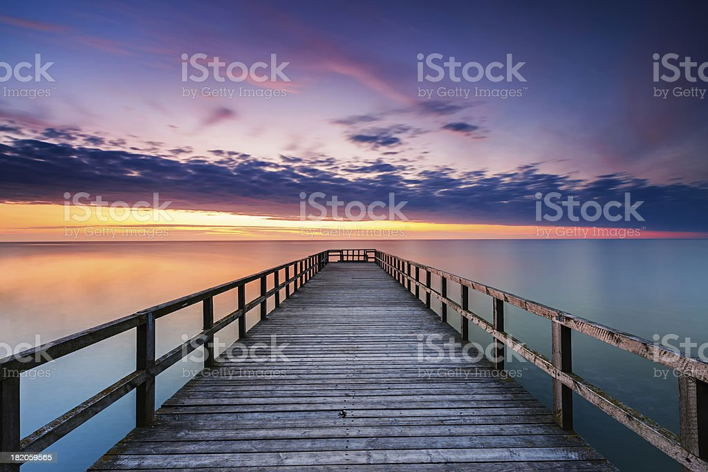 Jetty at sunset stock photo