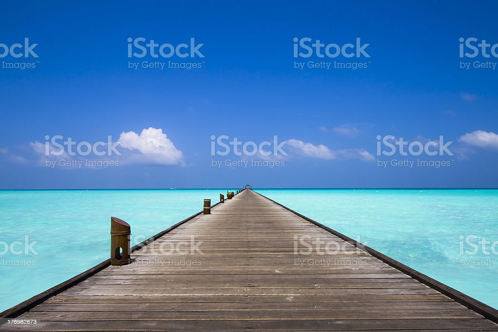 jetty at the beach stock photo