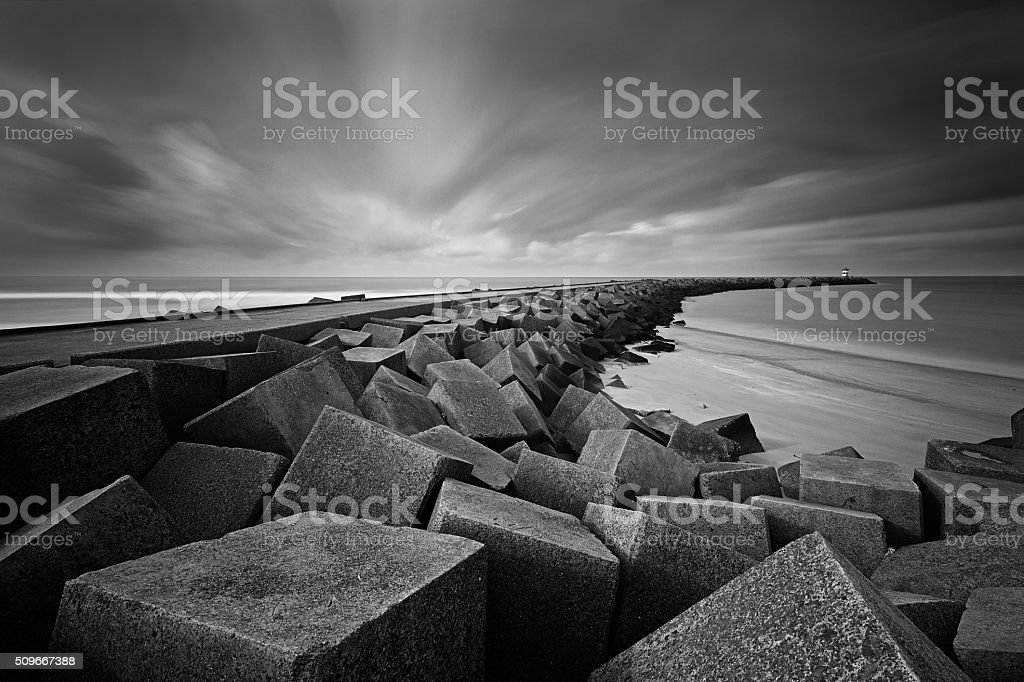 jetty at the entrance of Scheveningen' harbor stock photo