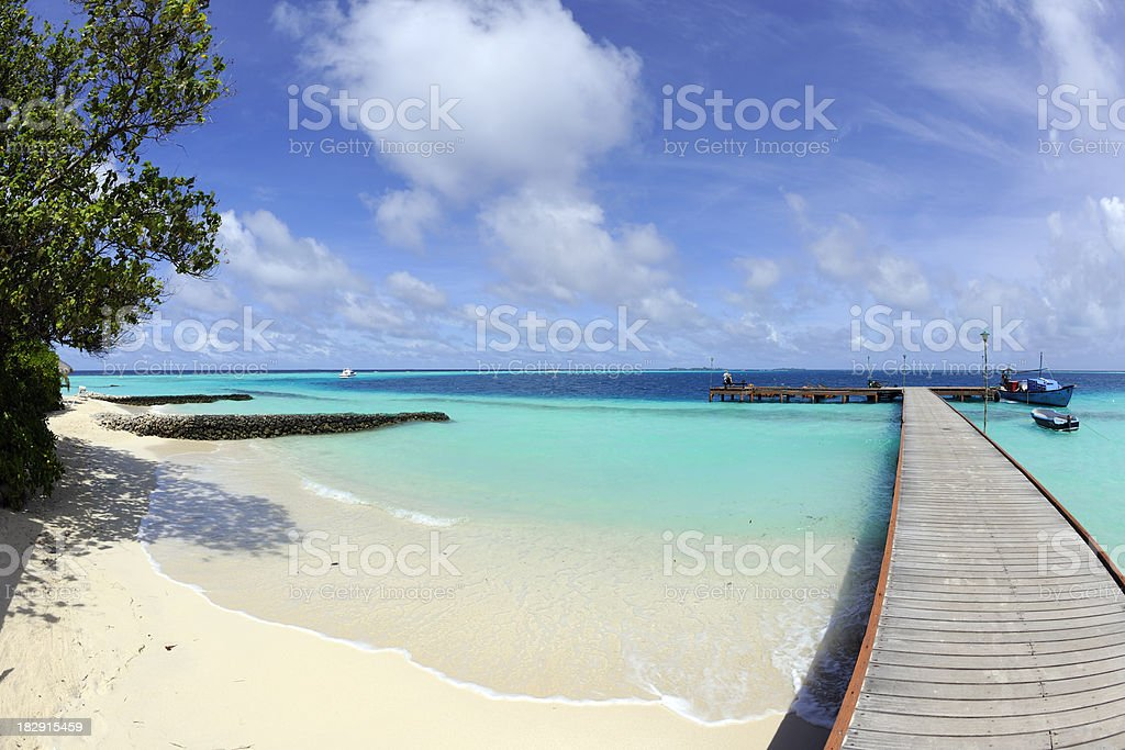 Jetty, beach and dhoni seen with a fisheye lens royalty-free stock photo