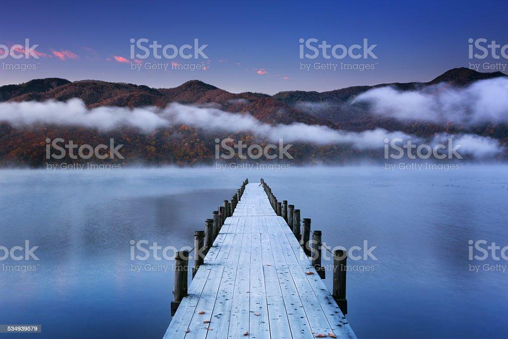Jetty in Lake Chuzenji, Japan at dawn stock photo