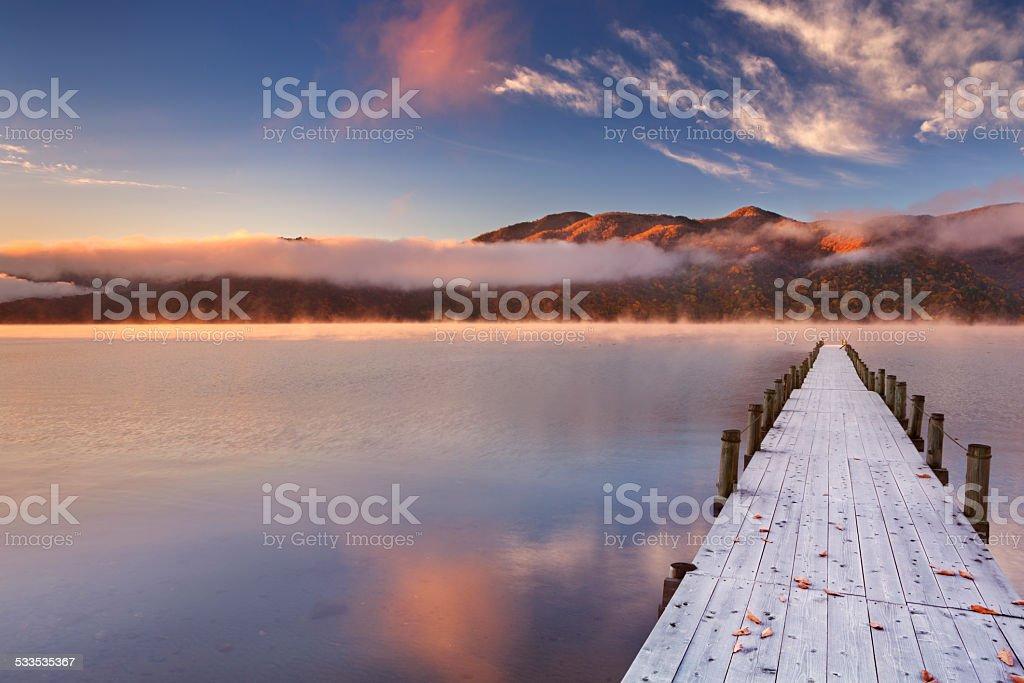Jetty in Lake Chuzenji, Japan at sunrise in autumn stock photo