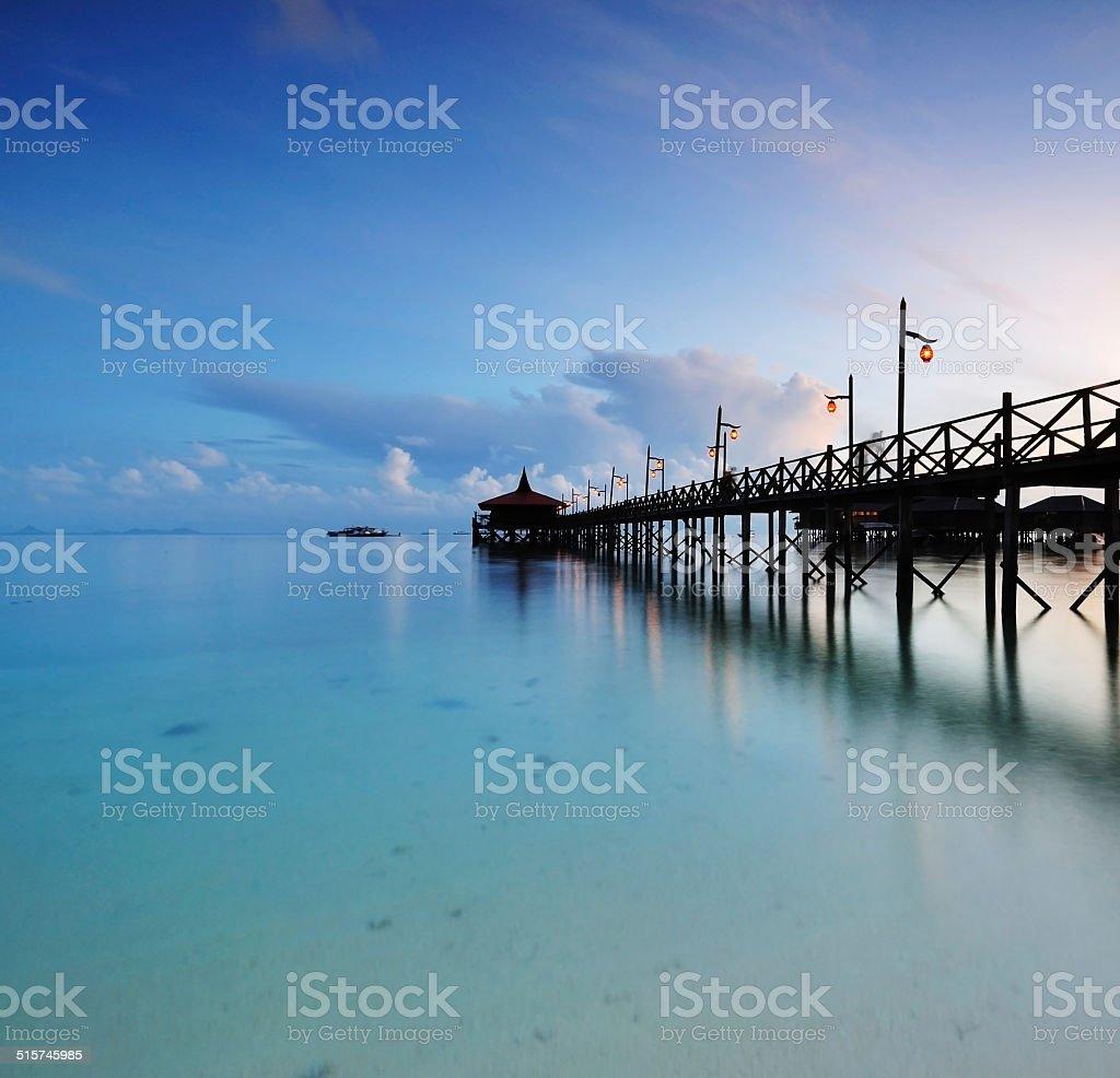 Jetty in Mabul Island at sunrise, long exposure stock photo
