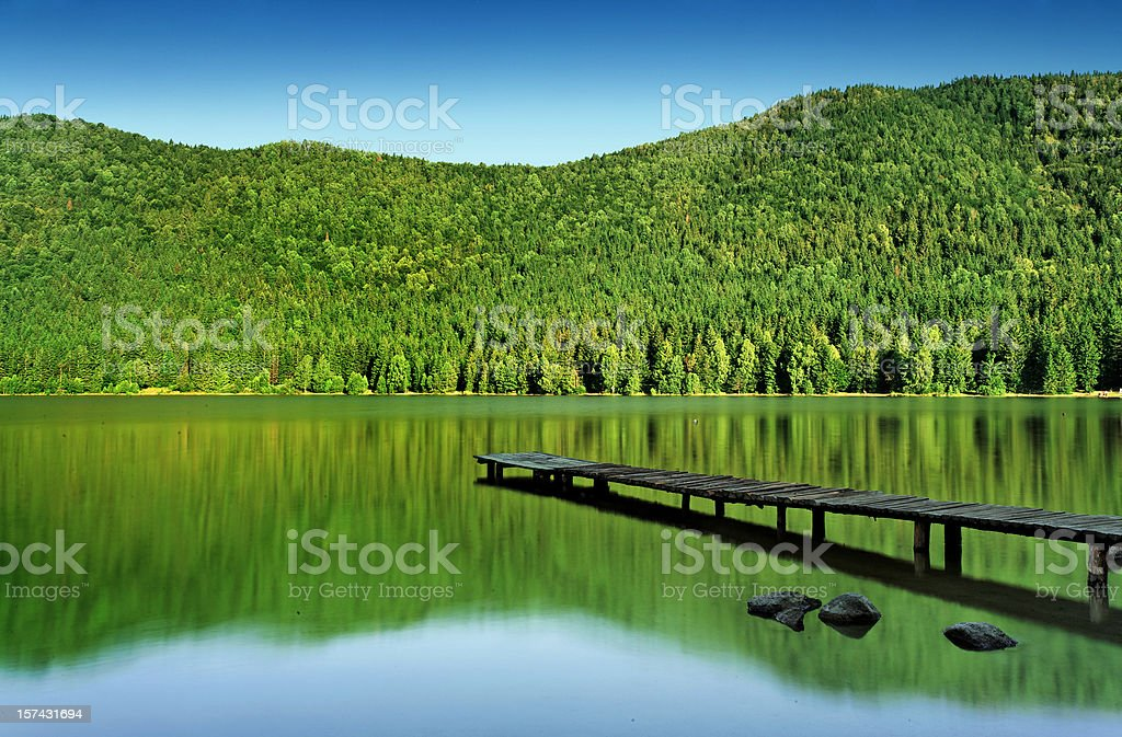 jetty in the mountain lake royalty-free stock photo