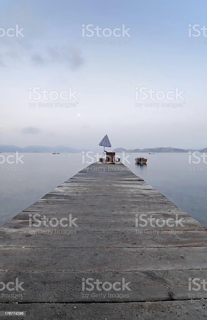 Jetty into a Mountain Lake royalty-free stock photo