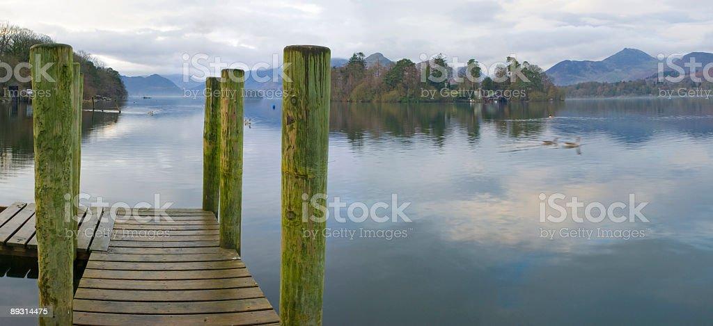 Jetty, lake, island, mountains stock photo