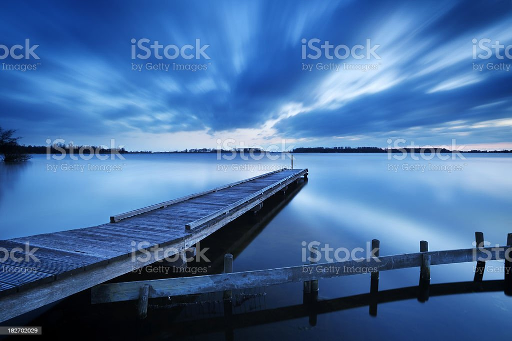 Jetty on a lake at dawn, near Amsterdam The Netherlands royalty-free stock photo