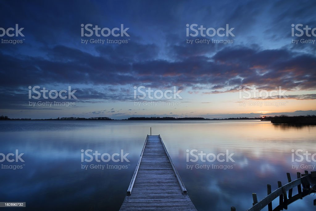 Jetty on a lake at sunrise, near Amsterdam The Netherlands royalty-free stock photo