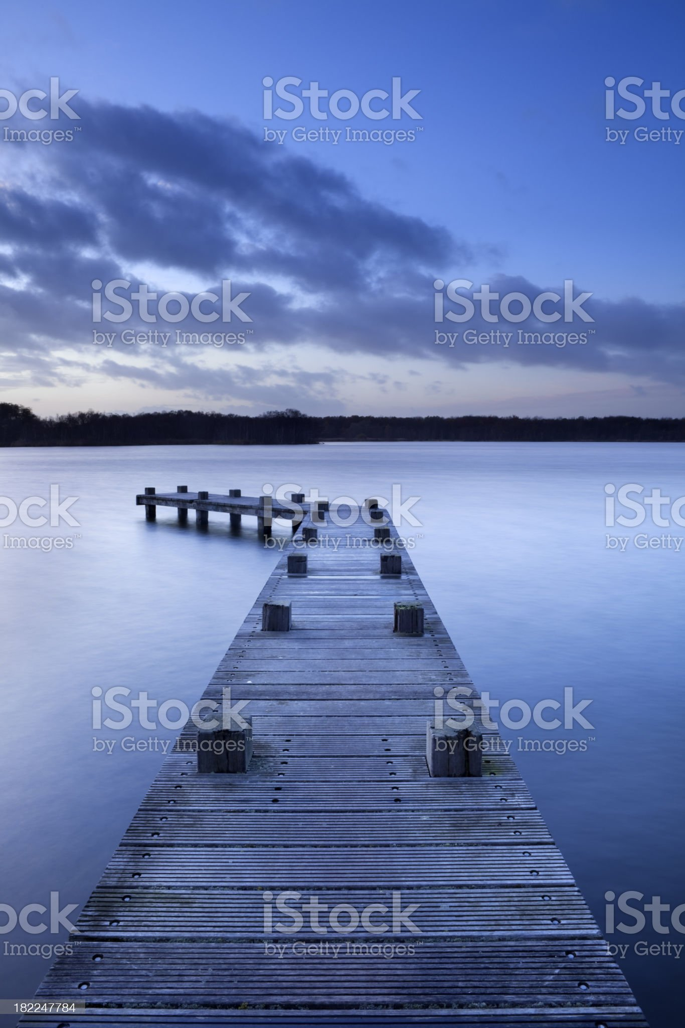 Jetty on lake at dusk in Amsterdamse Bos, The Netherlands royalty-free stock photo