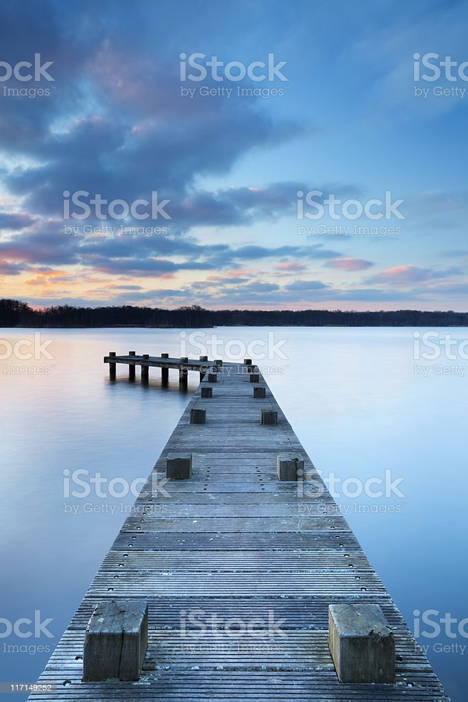 Jetty on lake at sunset in Amsterdamse Bos, The Netherlands stock photo