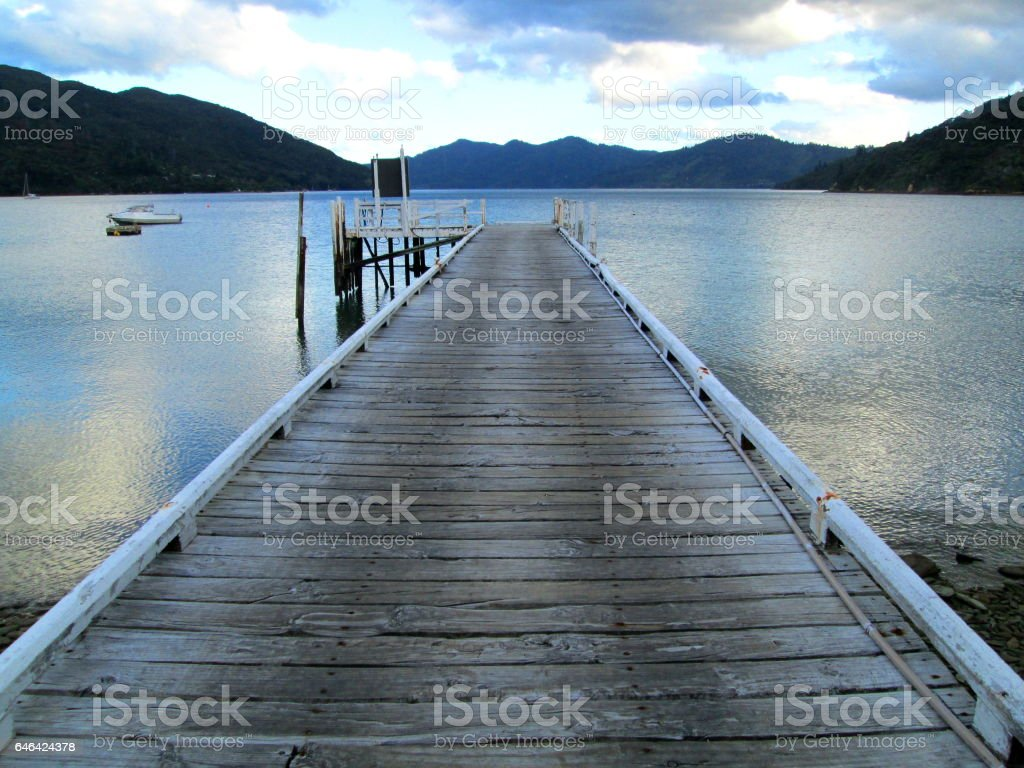 Jetty on lake at the Queen Charlotte Track, New Zealand stock photo
