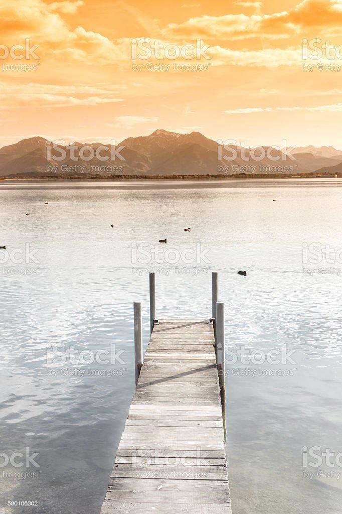 jetty on lake chiemsee stock photo