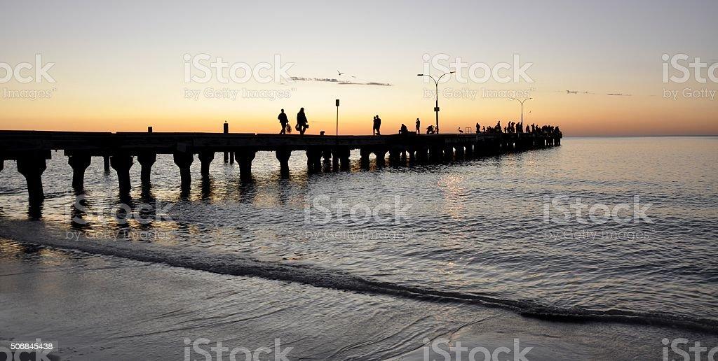 Jetty Silhouettes: Orange Sunset Skies stock photo
