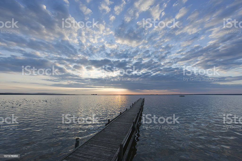 Jetty with magical cloudscape lakeside at sunset (XXL) royalty-free stock photo
