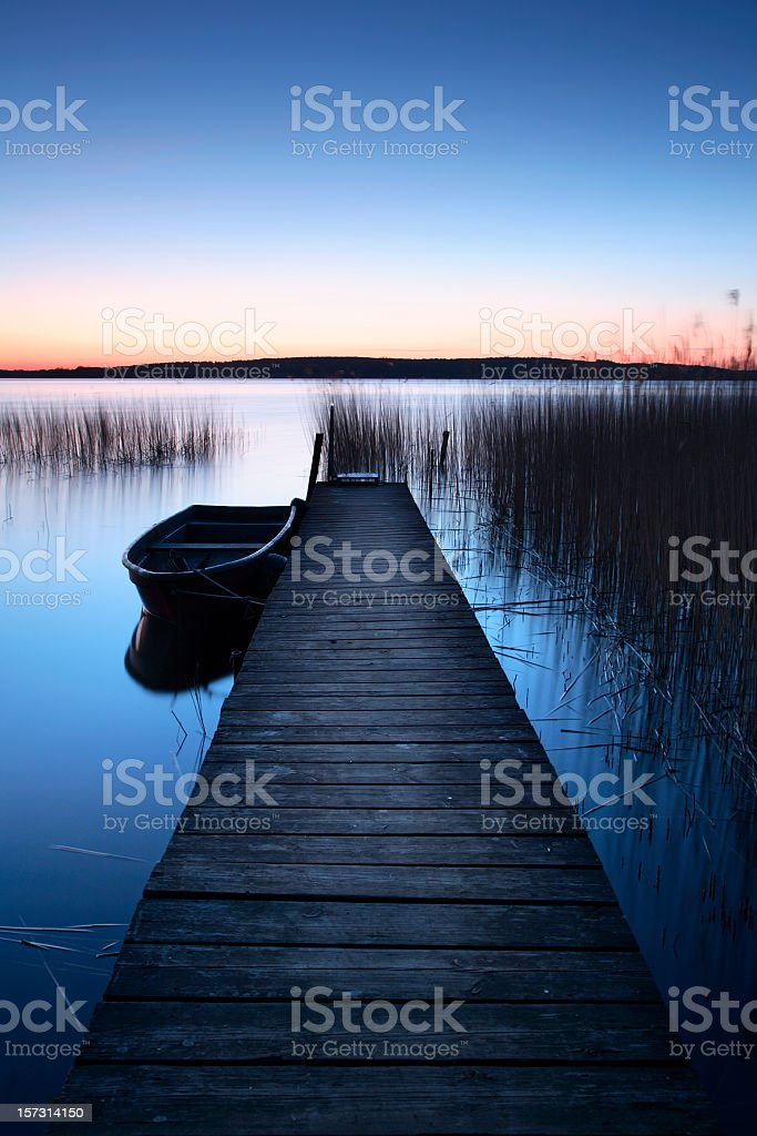 Jetty with Rowing Boat at Dawn royalty-free stock photo