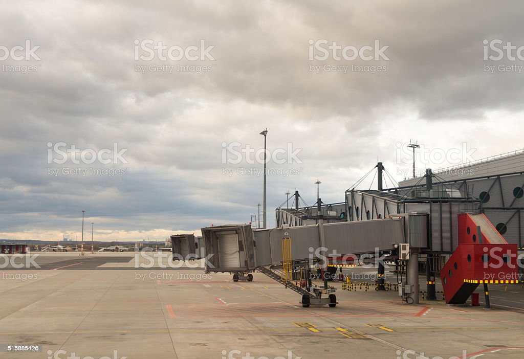 Jetway waiting for a plane to arrive on airport stock photo