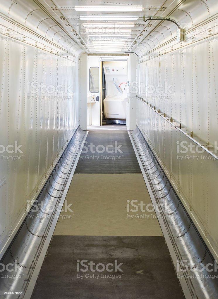 Jetway, walking towards the plane, selective focus stock photo