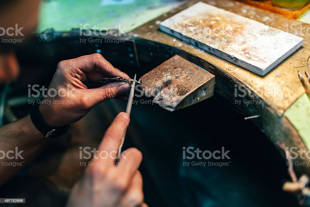 Jeweler crafting jewelry stock photo