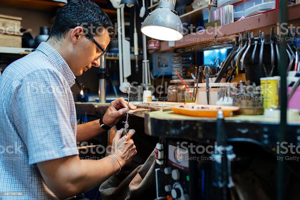 Jeweler desining jewelry stock photo
