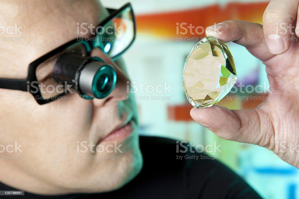 Jeweler looking at diamonds stock photo