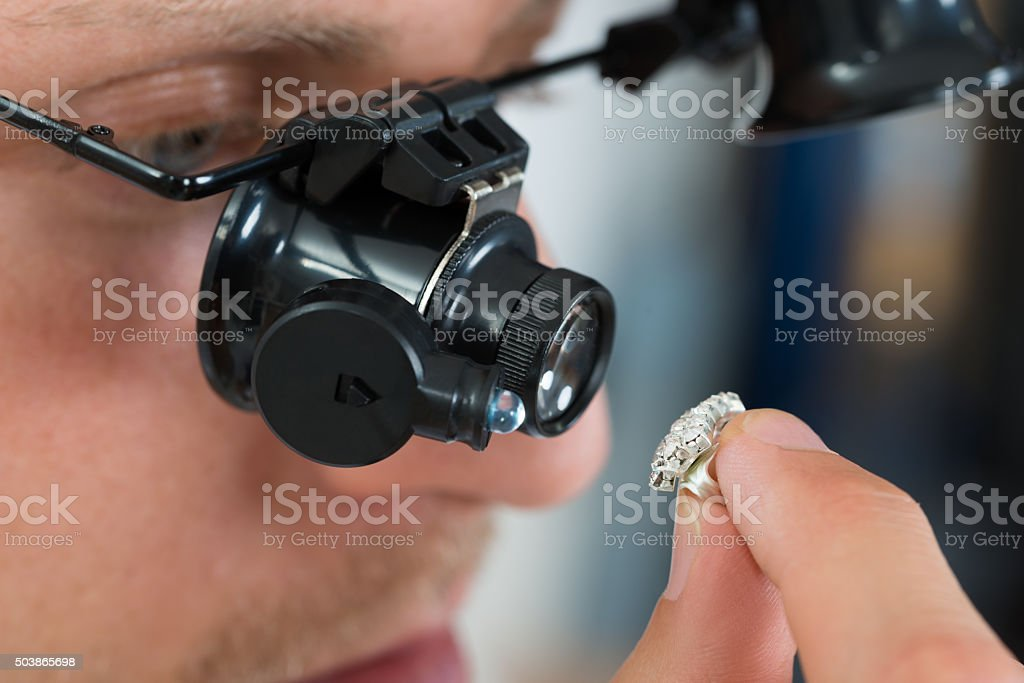 Jeweler Looking Ring With Loupe stock photo