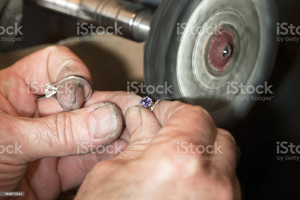 Jeweler Polishing a Amethyst and Diamond Ring stock photo