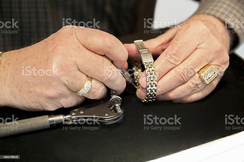 Jeweler repairs a watch stock photo