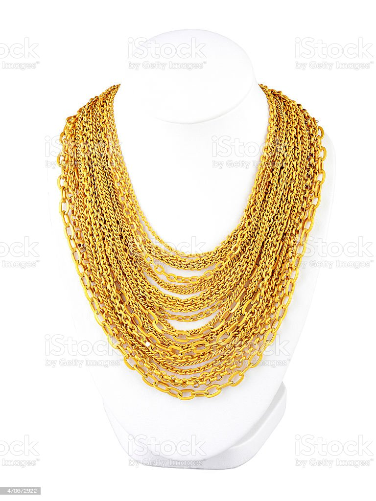Jeweler stand draped with dozens of gold chains stock photo