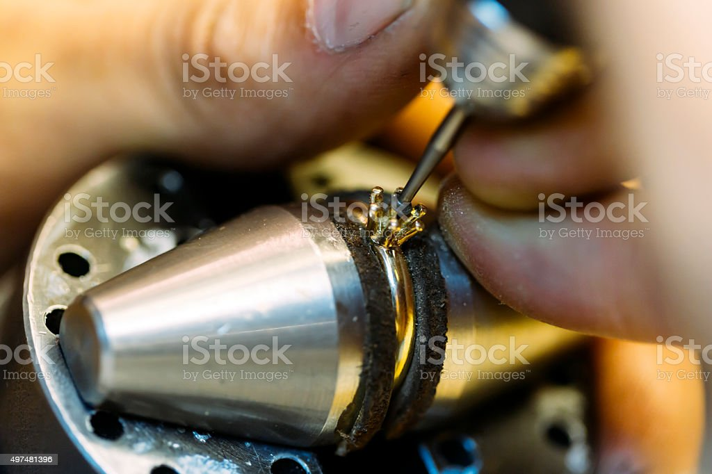 Jeweler working on a ring stock photo